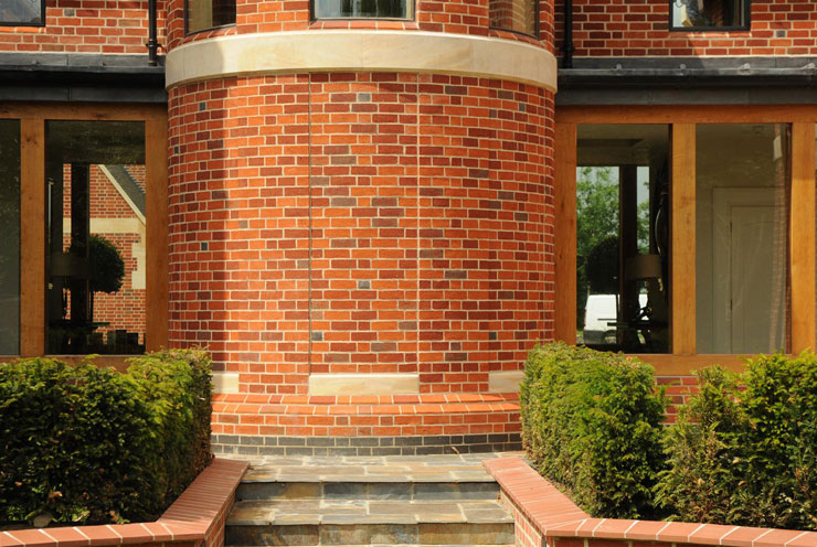 Red multi handmade facing brick with natural stone